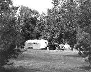 A 1936 Airstream Clipper being pulled by a Buick. It's one of the earliest models, as Airstream Trailer Company went into full production in 1932.
