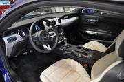 The interior of the 2015 Ford Mustang also has new features, including heated and cooling sets, a shrunken steering wheel and touch-screen navigation.