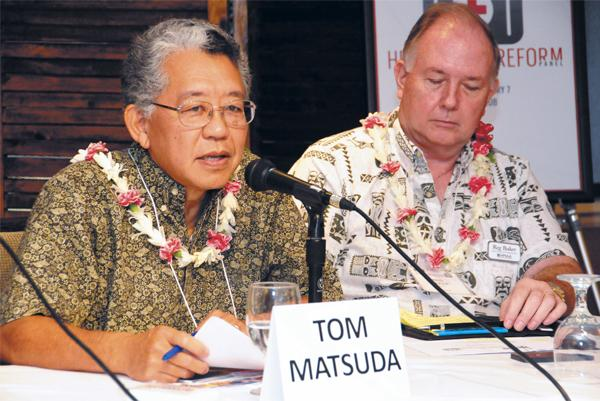 Tom Matsuda updates business executives on the status of the Hawaii Health Connector. Fellow panelist Reg Baker of HMAA is at right.