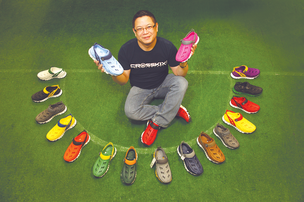 "Arthur Seto, operations director for Crosskix, showcases the startup's multi-colored footwear. ""We're going to create a huge array of colorways,"" Seto said."