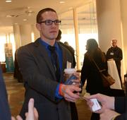 Rob Reed of C&S hands out business cards as the networking session continues.