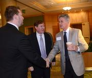 From left: James Moore of Borrelli & Partners and Brian Clark of C&S greet Jim Hamil of Terracon