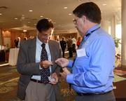 Vinay Mudholkar of All Aboard Florida exchanges business cards with Eugene Lozano of GRAEF
