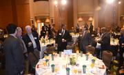 Guests find their tables in the meeting room as the networking session ends.