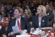 Phoenix Mayor Greg Stanton enjoys the Dynamic Women in Business presentation with his wife Nicole, who delivered the keynote address.
