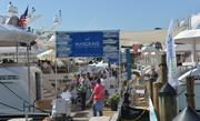 Attendees crowd the docks of the 2014 Miami International Boat Show.