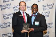 From left: Robert Mason, BB&T and Darryl Willie, Teach for America at the Business Journal's 40 Under 40 luncheon April 4. Willie was one of the 2013 40 Under 40 honorees.