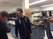 Berkeley BioLabs CEO Ryan Bethencourt (center) and Chief Scientific Officer Ron Shigeta talk to prospective users of the biohacking space.