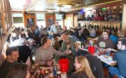 Patrons share bottles during Belgian Beer Fest at Max's Taphouse on Friday morning.
