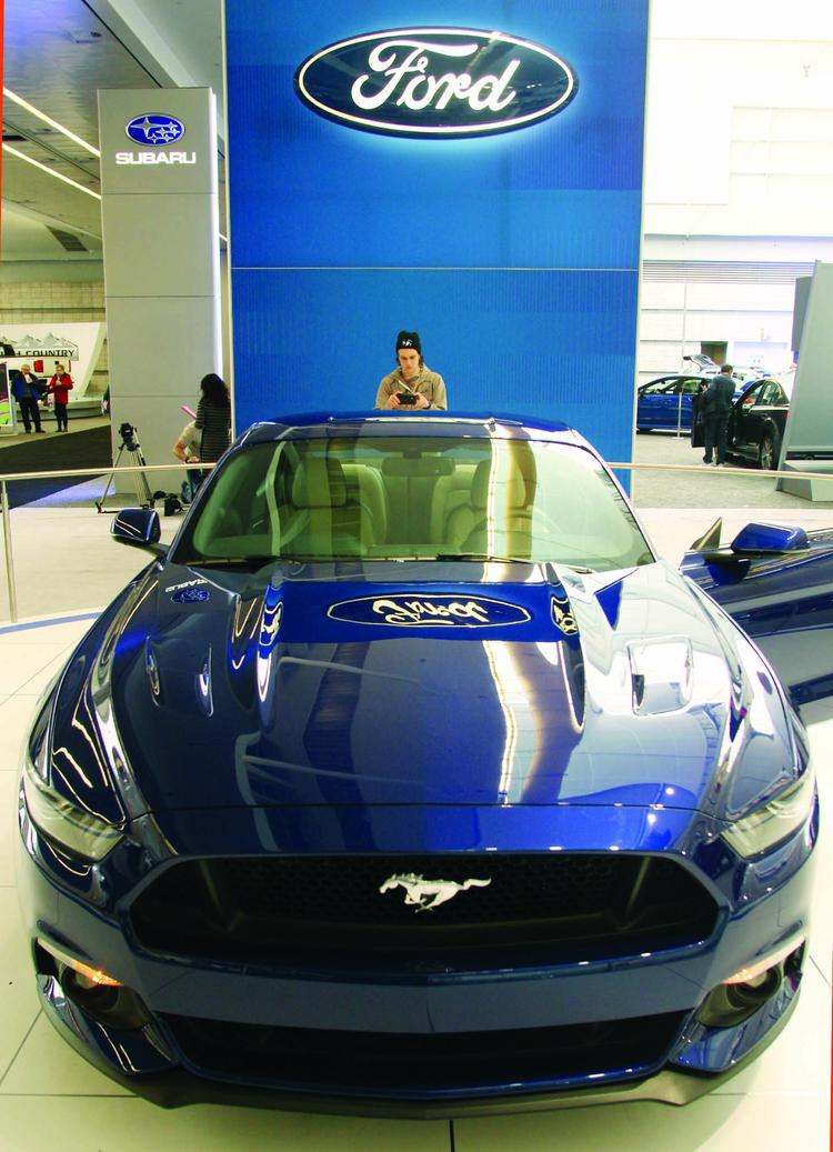 Luke Serra of Finleyville photographs a 2015 Ford Mustang GT 5.0 on Friday, Feb. 14 at the Pittsburgh International Auto Show, being held through Monday at the David L. Lawrence Convention Center.
