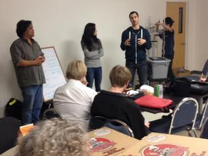 Berkeley BioLabs' Ron Shigeta, left, Sunny Allen and Ryan Bethencourt talk to potential tenants and volunteers at a meetup Thursday night.