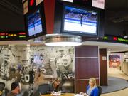 A meeting area in Learfield Sports' Plano corporate office with a basketball court scoreboard as a fixture.