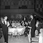 The longstanding Seattle arts organization PONCHO pioneered the use of fundraising galas among local nonprofits with a 1963 auction, shown above, to save the Seattle Symphony. The group raised $35 million for arts groups over 50 years but disbanded in February.