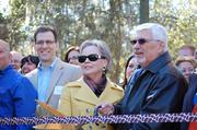 From left: Inez and Bob Parsell of the Central Florida Zoological Society Inc. cut the ribbon, officially opening the new giraffe exhibit.