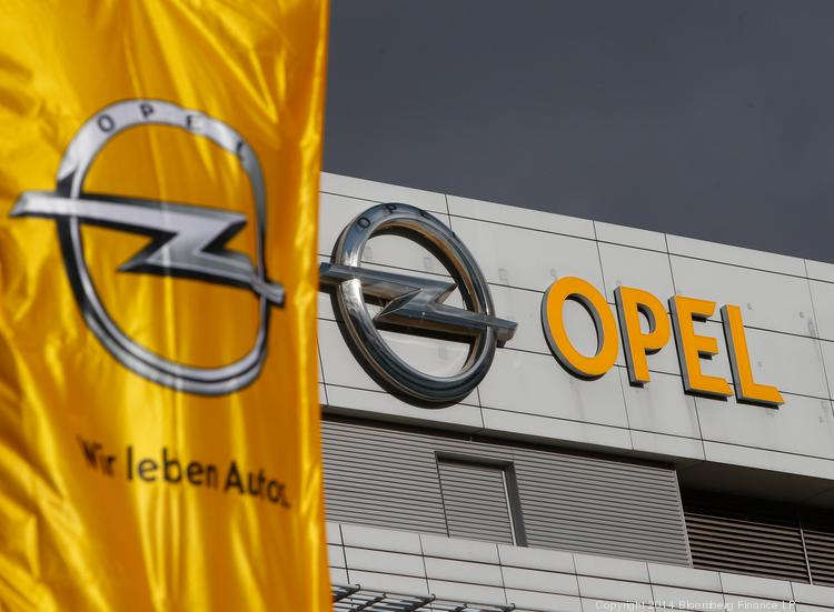 The Opel logo on the exterior of General Motors Co.'s (GM) Opel unit headquarters in Ruesselsheim, Germany. GM is closing an Opel plant in Bochum, Germany, which will result in Johnson Controls Inc. cutting employees from a plant in Germany.