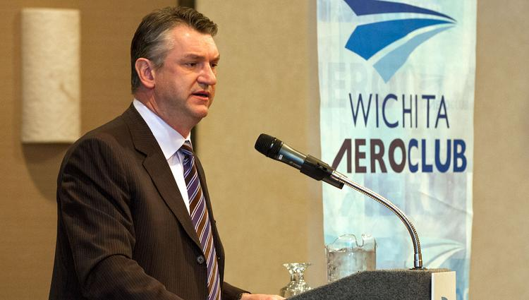 President and CEO of Spirit Aero Systems Larry Lawson speaks with guests of the Wichita Aero Club February luncheon.
