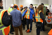 Local junior and senior high school students don safety vests and hard hats for a tour of the Park Avenue West construction site as part of National Engineers Week.