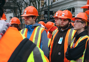 Students listen as engineers explain some of the technical components of construction of Park Avenue West in downtown Portland.