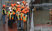 Local students peer into the construction site of Park Avenue West during a visit to downtown Portland in conjunction with National Engineers Week.