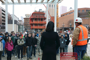Aspiring engineers from area high schools gather at Directors Park in downtown Portland for a tour of Park Avenue West, the 32-story  tower now under instruction next door, at 728 S.W. Park Ave.