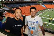 Daniel Chun, left, regional manager and sales and community marketing for Alaska Airlines, and Dusty Loffarelli, sales executive for United Airlines, inside Aloha Stadium at the finish of the Great Aloha Run.