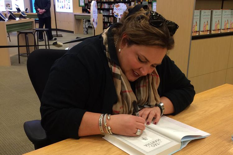 Jen Lancaster signs a book at the Barnes & Noble Booksellers in the St. Johns Town Center.