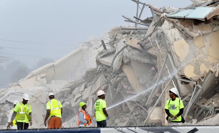 Workers hose down the debris of the former Howard Johnson hotel, which was demolished Feb. 18 in Fort Lauderdale Beach.