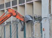 Construction equipment is used to weaken the supports of the hotel.