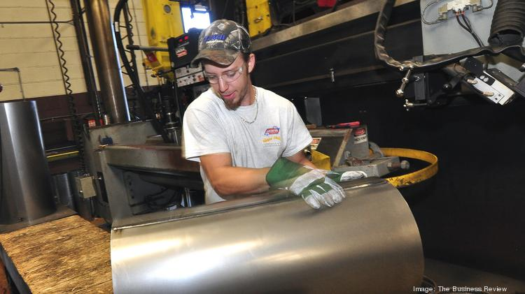 Mark Case Jr. uses a seamless welder to fabricate drum at Hannay Reels, a Westerlo, NY manufacturer.