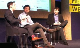 Derek Thomson (left) of <em>The Atlantic</em> interviews Upworthy co-founders Peter Koechley (center) and Eli Pariser (right).