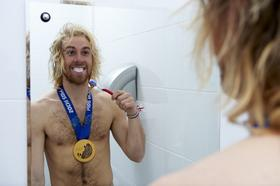 Sage Kotsenburg, gold medal winner of Men's Snowboard Slopestyle, casual brushing his teeth during photo shoot at Main Media Center in  Sochi, Russia on February 10, 2014.