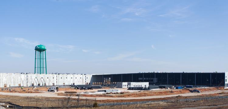 The new Amazon.com Inc. warehouse in Southeast Baltimore is under construction. A second, 346,000-square-foot warehouse will be built nearby.