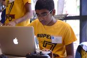 Nikhil Chittaluru of Team Super 7 runs a systems check on his laptop. Remember the 8th grade? If you're like me, it did not involve running systems checks on a laptop.