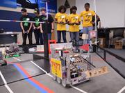 Team Robo GT of University High and Team Super 7 marvel at their creations.