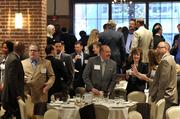 The crowd gathering for the event included (center, left to right) Robert Tullar, Steve Preston and Jennifer Goad of General Dynamics.
