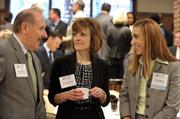 From left: Steve Preston, Jennifer Goad and award recipient Amy Wilbur, all General Dynamics