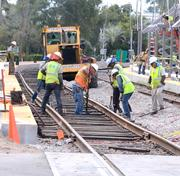 Work crews reinforce the tracks by the Winter Park Train station. The station will be used for All Aboard Florida and SunRail.