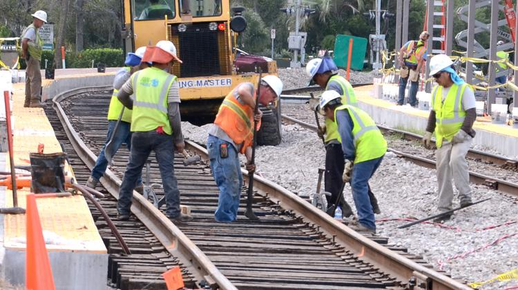 The city of Austin doesn't expect an urban rail plan and other transit projects to impact its bond rating, but does expect citizens will see a property tax hike to pay for the improvements if a November ballot makes it past voters.