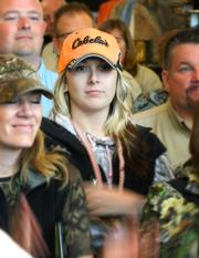 Employees listen to Cabela's executives prior to the store opening.