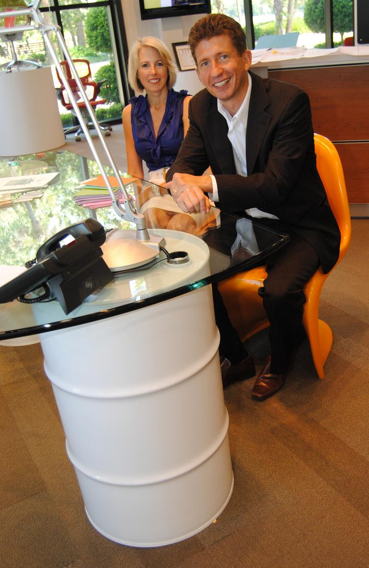 Elizabeth Dvorak of Workscapes Inc. and Tony Chapple of Pelliconi Group sit at the unique desk design made by Workscapes Inc.