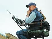 Tim Herald was ready to shoot a crossbow to cut the ribbon for the Cabela's grand opening.