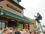 Tim Herald sat on a ladder in front of the new Cabela's in preparation for the  grand opening.