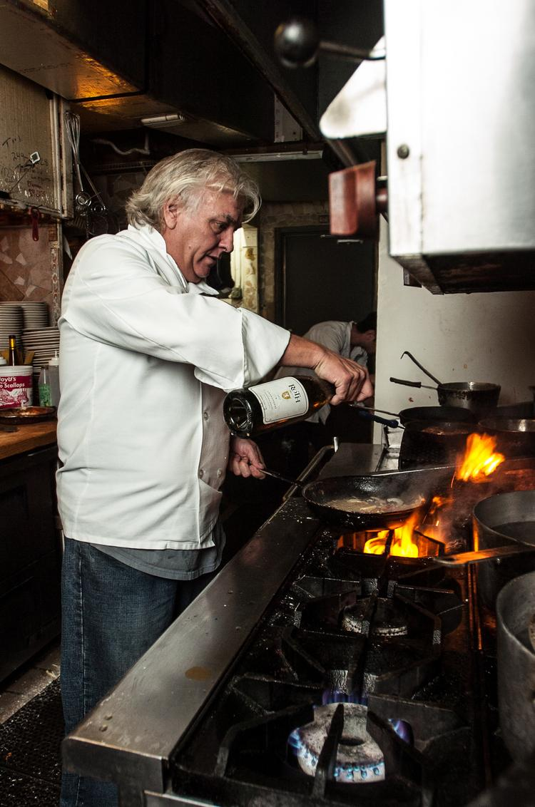Dwight Delude in action at the Jacksonville Beach restaurant he opened 17 years ago.