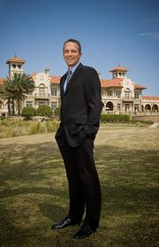 Jared Rice of the PGA Tour with the TPC Sawgrass clubhouse in the background.