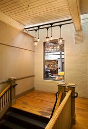 The stairs at Rejuvenation's Central Eastside store in Portland lead to Garrison Hullinger Interior Design's office on the second floor.