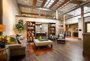 Garrison Hullinger Interior Design converted former storage space on the second floor of the Rejuvenation store in Portland's Central Eastside Industrial District into its working studio.