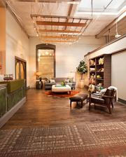 Garrison Hullinger Interior Design converted former storage space on the second floor of the Rejuvenation store in Portland's Central Eastside Industrial District into its working studio. Above, the entry lobby doubles as a display and welcomes Rejuvenation shoppers.