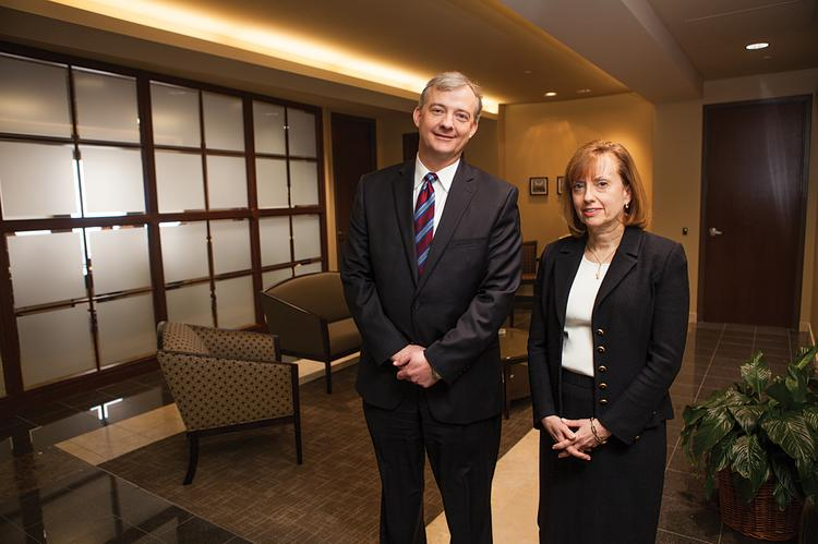 Dean Dorton president and CEO David Bundy, left, and Louisville office managing director Gwen Tilton are shown in the lobby of the PNC Plaza office space where the accounting firm relocated last year.