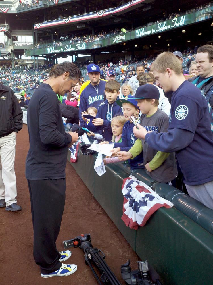 Former Mariner pitcher Jamie Moyer signs autographs before throwing the ceremonial first pitch in the team's home opener April 8 in Safeco Field. The Ms defeated the Houston Astros, 3-0.