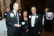 L to R: George Oliver, President & CEO, Tyco with honoree Board Director, Raj Gupta and wife.